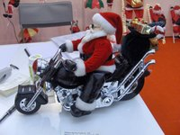 Santa_riding_motorcycle_battery_ope